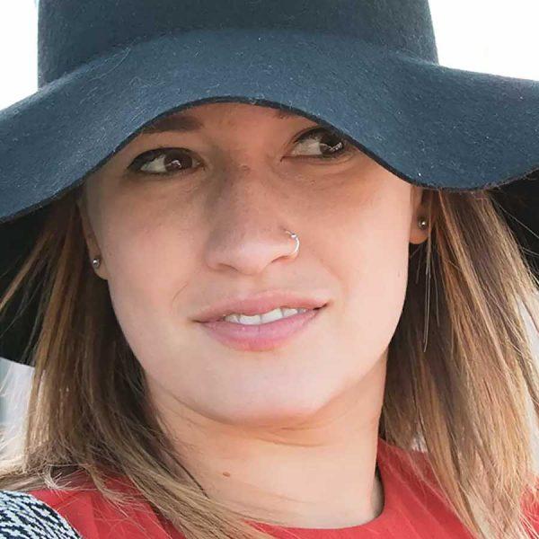 Woman in floppy black hat