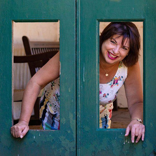 Woman leaning through doorway