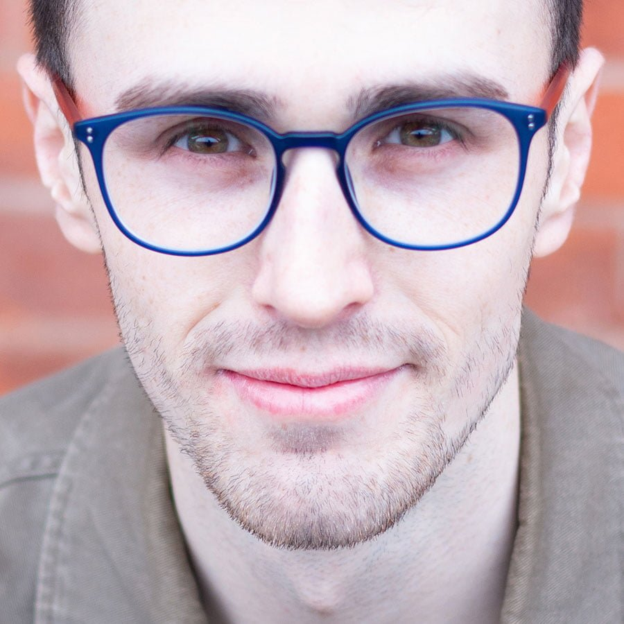 Male wearing blue framed glasses