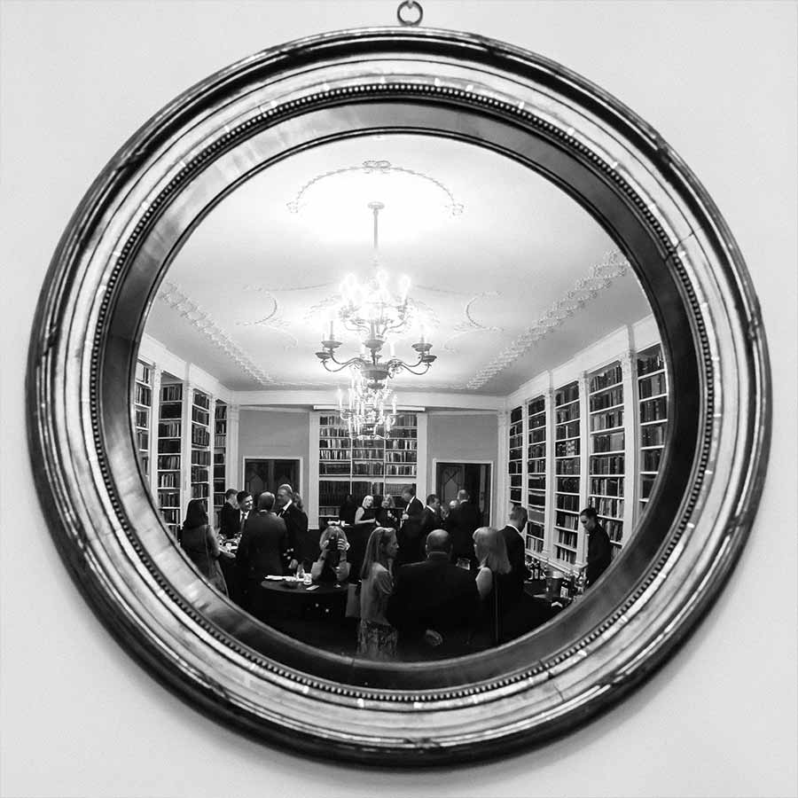 Reflection in mirror at an event at The Royal Institution, London