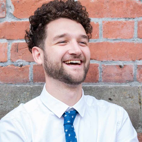 LinkedIn headshot of male in shirt and tie