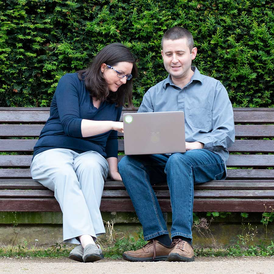 Team photo of two colleagues sat on a bench at Highfields, Nottingham - part of my corporate photography package