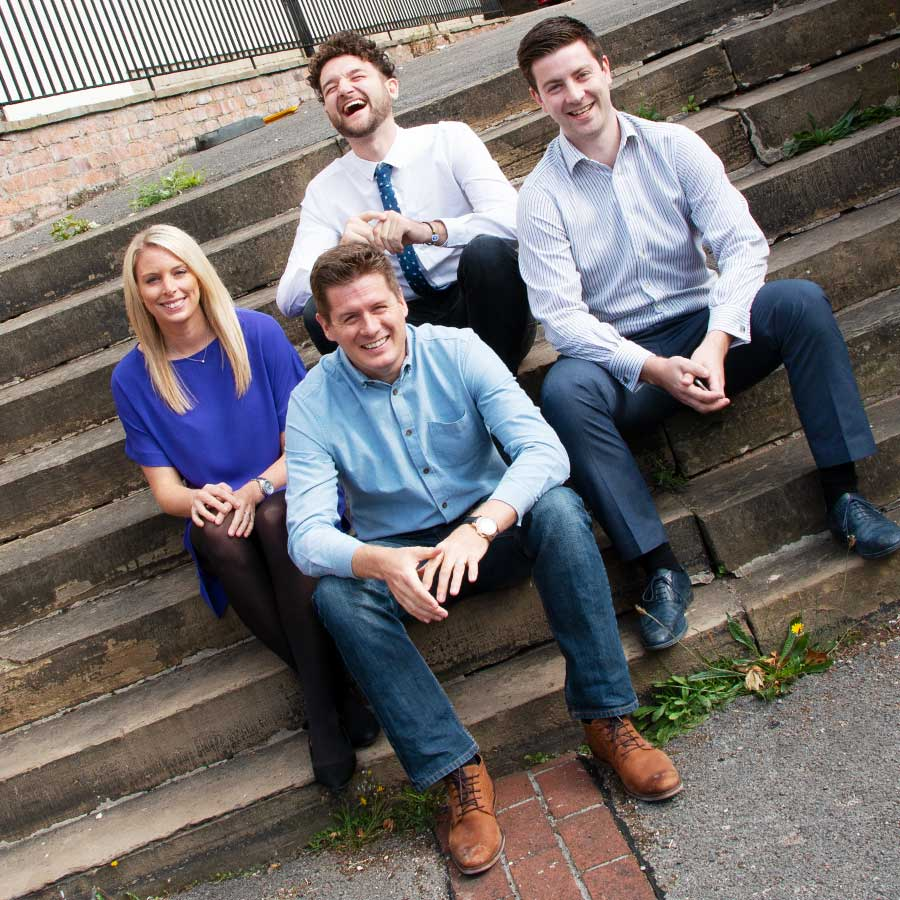 The InTouch team sitting on steps, Nottingham - part of my corporate photography package