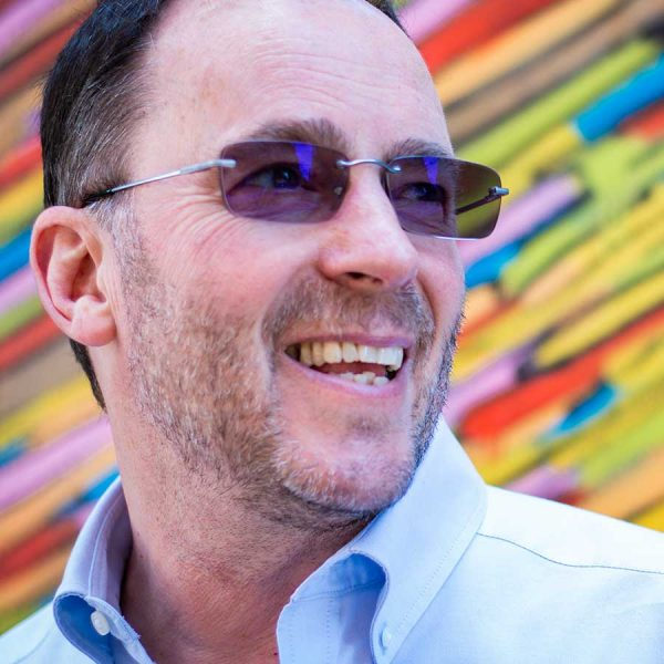 Male in front of multicoloured background on a corporate photo shoot
