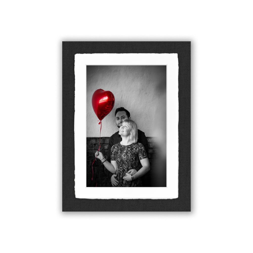 A photo of a couple holding a red heart balloon in the Amalfi frame